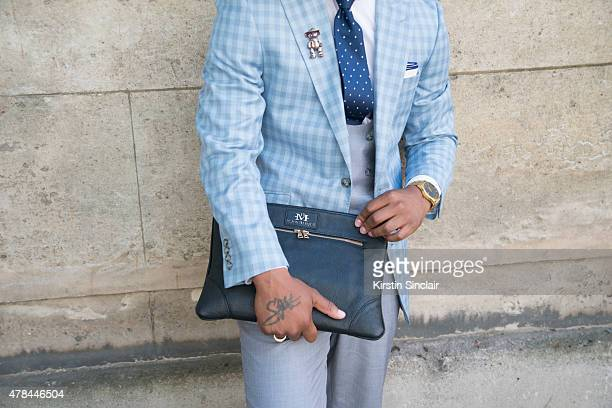 Fashion Designer Dejon Marquis wears a Hugo Boss tie Tommy Hilfiger shirt Tailor made suit and waistcoat and a Dejon Marquis bag on day 1 of Paris...
