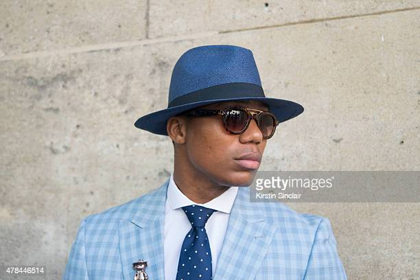 Fashion Designer Dejon Marquis wears a Hugo Boss tie Tommy Hilfiger shirt Tailor made suit vintage sunglasses and hat on day 1 of Paris Collections...