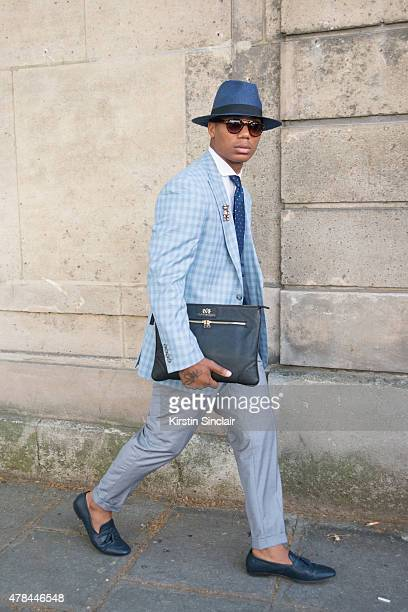 Fashion Designer Dejon Marquis wears Zara shoes Hugo Boss tie Tommy Hilfiger shirt Tailor made suit and waistcoat vintage sunglasses and hat and a...