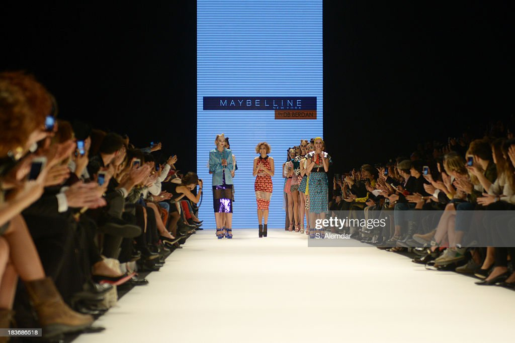 Fashion designer Deniz Berdan (C) walks the runway at the Maybelline New York By DB Berdan show during Mercedes-Benz Fashion Week Istanbul s/s 2014 presented by American Express on October 8, 2013 in Istanbul, Turkey.