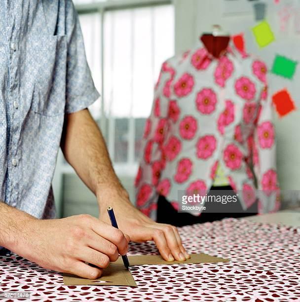 Fashion designer designing a garment