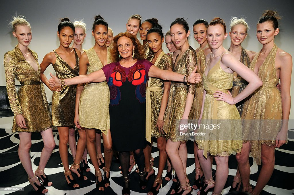 Fashion designer Diane von Furstenberg (C) and models attend the American Express UNSTAGED Fashion with DVF at Spring Studios on February 9, 2014 in New York City.
