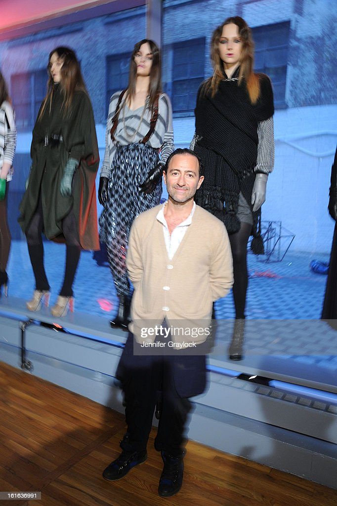 Fashion designer Diego Binetti and Models pose during the Diego Binetti Fall 2013 Mercedes-Benz Fashion Presentation held at Westbeth Gallery on February 13, 2013 in New York City.