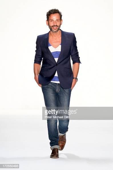Fashion designer Dimitrios Panagiotopoulos on the runway after his Dimitri show during MercedesBenz Fashion Week Spring/Summer 2014 at Brandenburg...