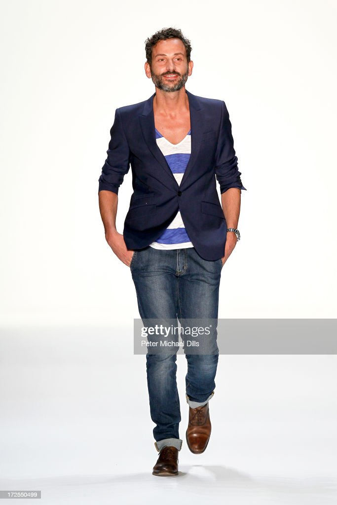 Fashion designer Dimitrios Panagiotopoulos on the runway after his Dimitri show during Mercedes-Benz Fashion Week Spring/Summer 2014 at Brandenburg Gate on July 3, 2013 in Berlin, Germany.