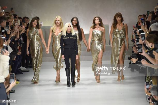 Fashion designer Donaltella Versace walks the runway finale with Supermodels Carla Bruni Claudia Schiffer Naomi Campbell Cindy Crawford and Helena...