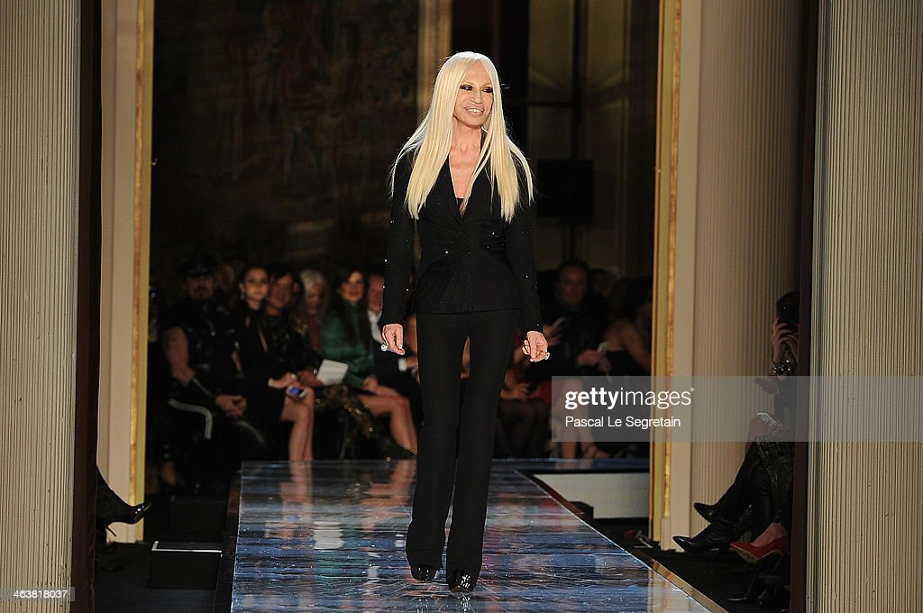 Fashion designer <a gi-track='captionPersonalityLinkClicked' href=/galleries/search?phrase=Donatella+Versace&family=editorial&specificpeople=202209 ng-click='$event.stopPropagation()'>Donatella Versace</a> acknowledges the applause of the audience during Atelier Versace show as part of Paris Fashion Week Haute-Couture Spring/Summer 2014 on January 19, 2014 in Paris, France.