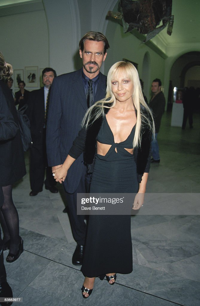 Fashion designer Donatella Versace and her husband Paul Beck attend a Bruce Weber retrospective at the National Portrait Gallery in London, 18th November 1997.