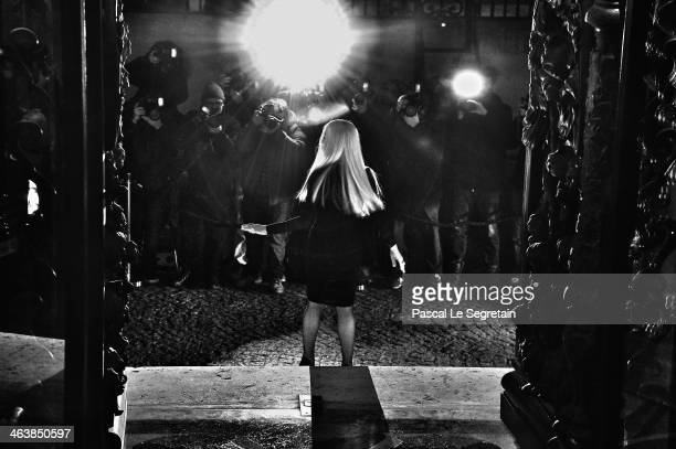 Fashion designer Donatella Versace arrives to attend the Atelier Versace show as part of Paris Fashion Week Haute Couture Spring/Summer 2014 on...