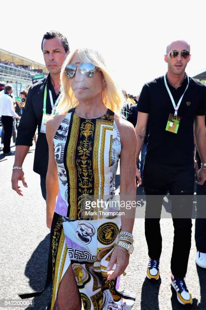 Fashion designer Donatella Versace walks on the grid before the Formula One Grand Prix of Italy at Autodromo di Monza on September 3 2017 in Monza...