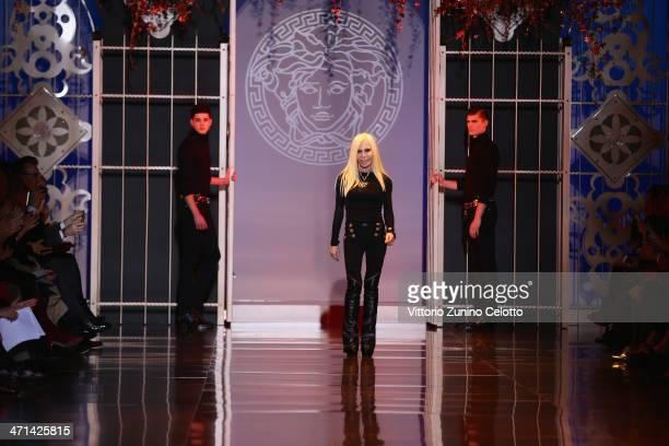 Fashion designer Donatella Versace walks the runway after the Versace fashion show during Milan Fashion Week Womenswear Autumn/Winter 2014 on...