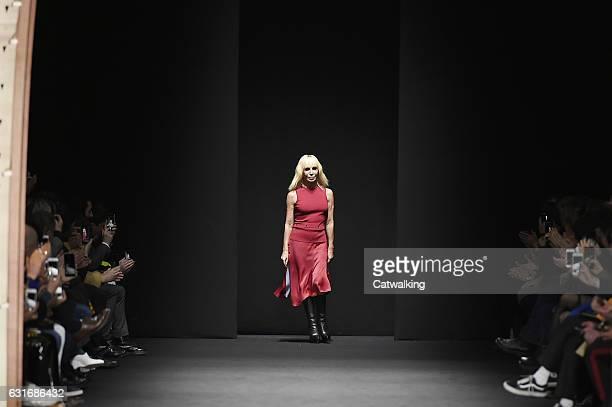 Fashion designer Donatella Versace walks the runway at the Versace Autumn Winter 2017 fashion show during Milan Menswear Fashion Week on January 14...