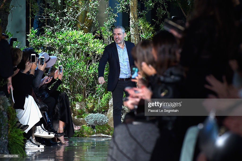 Fashion designer <a gi-track='captionPersonalityLinkClicked' href=/galleries/search?phrase=Elie+Saab+-+Fashion+Designer&family=editorial&specificpeople=4979945 ng-click='$event.stopPropagation()'>Elie Saab</a> acknowledges the applause of the audience after his show as part of Paris Fashion Week Haute Couture Spring/Summer 2015 on January 28, 2015 in Paris, France.