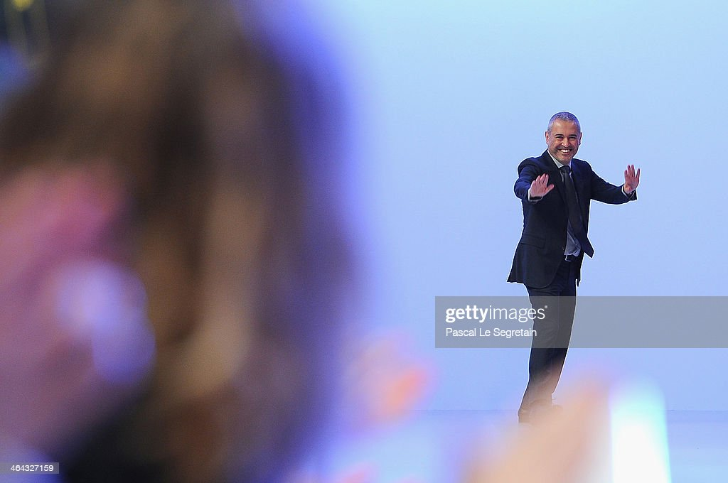 Fashion designer Elie Saab acknowledges the applause of the audience after his show as part of Paris Fashion Week Haute Couture Spring/Summer 2014 on January 22, 2014 in Paris, France.