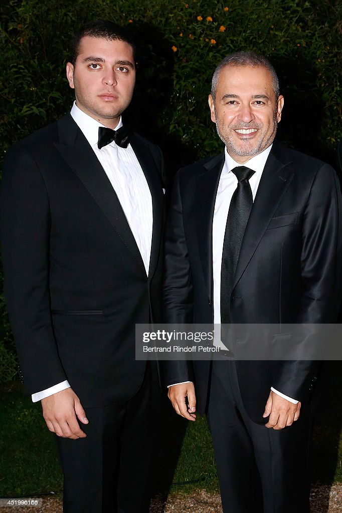 Fashion designer Elie Saab (R) and his son Elie Saab attend the 'Chambre Syndicale de la Haute Couture' Cocktail, to celebrate the end of the Paris Fashion Week. Held at Hotel Salomon de Rothschild on July 10, 2014 in Paris, France.
