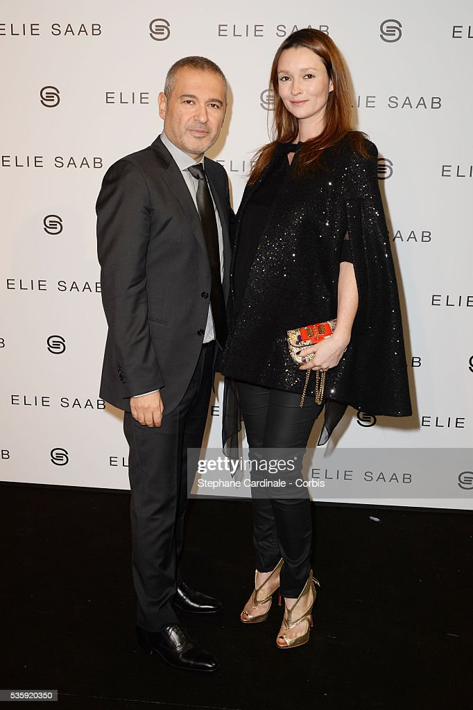 Fashion designer Elie Saab poses with Audrey Marnay after his show as part of Paris Fashion Week Haute Couture Spring/Summer 2014 , at Theatre National de Chaillot, in Paris.