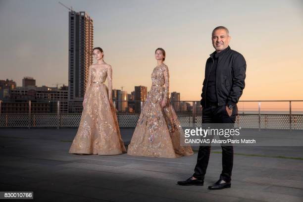 Fashion designer Elie Saab with 2 models wearing clothes from of his new collection are photographed for Paris Match on June 24 2017 in Beirut Lebanon