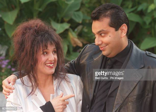 Fashion designer Elizabeth Emanuel with her new business partner Shami Ahmed the businessman behind the clothing empire 'Joe Bloggs' at a photocall...