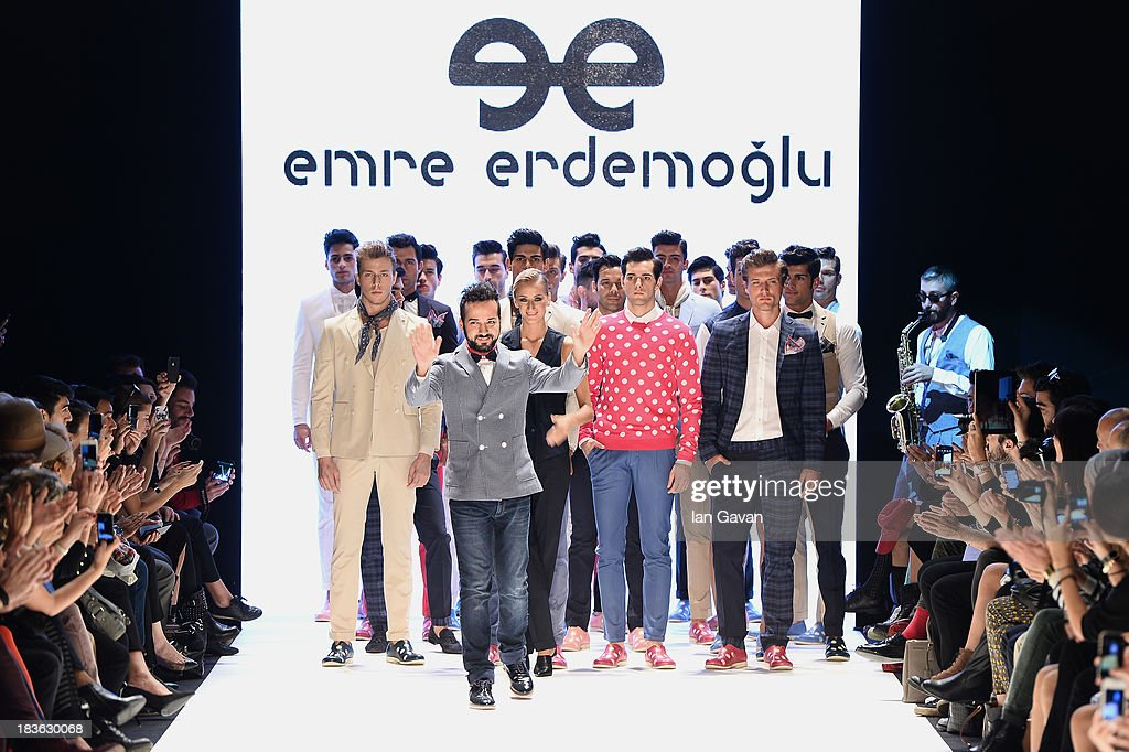 Fashion designer Emre Erdemoglu (C) and models walk the runway at the Emre Erdemoglu show during Mercedes-Benz Fashion Week Istanbul s/s 2014 presented by American Express on October 8, 2013 in Istanbul, Turkey.