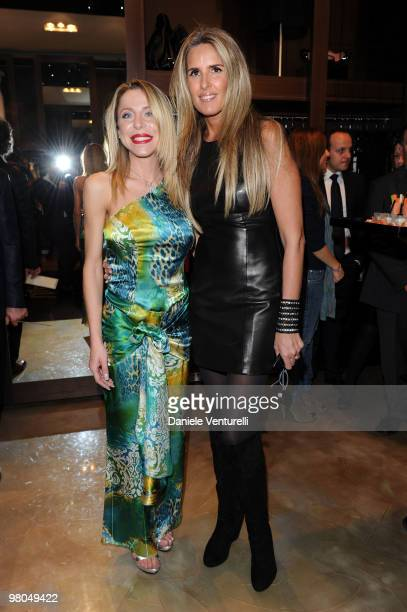 Fashion designer Ester Maria Rivaroli and Tiziana Rocca attend the Ester Maria Rivaroli Flagship Store Opening on March 25 2010 in Rome Italy