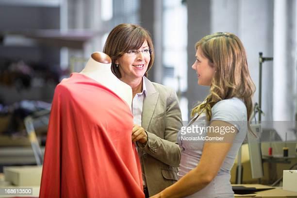 Fashion designer explaining her technique to customer
