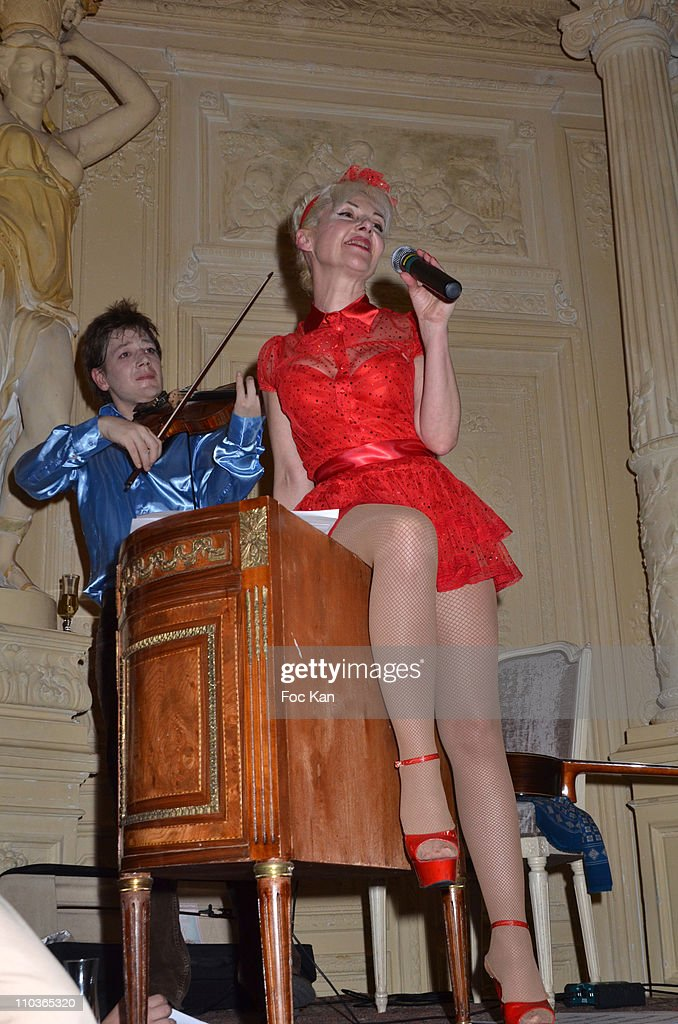 Fashion designer Fifi Chachnil and a violinist (L) attend the Philippe Katerine and Fifi Chachnil Concert At the 'Carmen' on March 1, 2011 in Paris, France.