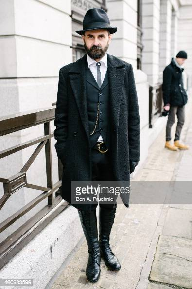 Fashion designer Florin Dobre poses wearing items he has designed himself at the Matthew Miller catwalk presentation during The London Collections...