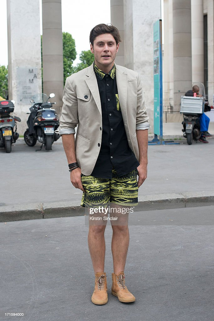 Fashion designer for Monsier and Madone Gaulthier Lefeure wears Twins for peace shoes and a Moniser and Madone shorts, jacket and shirt on day 1 of Paris Collections: Men on June 26, 2013 in Paris, France.