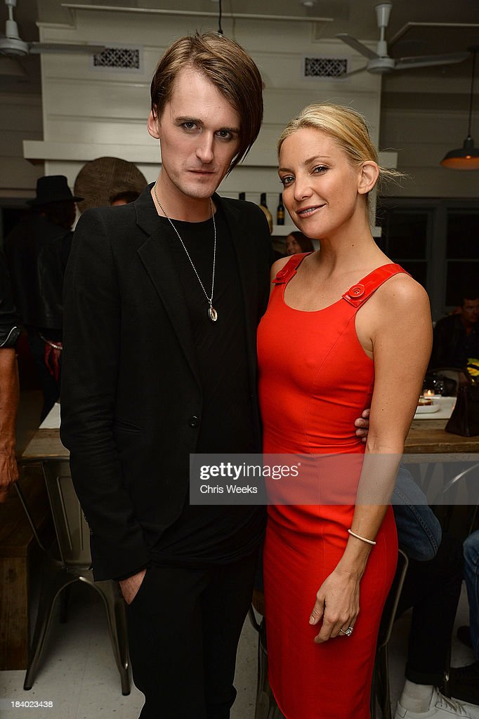 Fashion designer Gareth Pugh and actress Kate Hudson attend a dinner for Pugh hosted by Chrome Hearts at Malibu Farm on October 10, 2013 in Malibu, California.