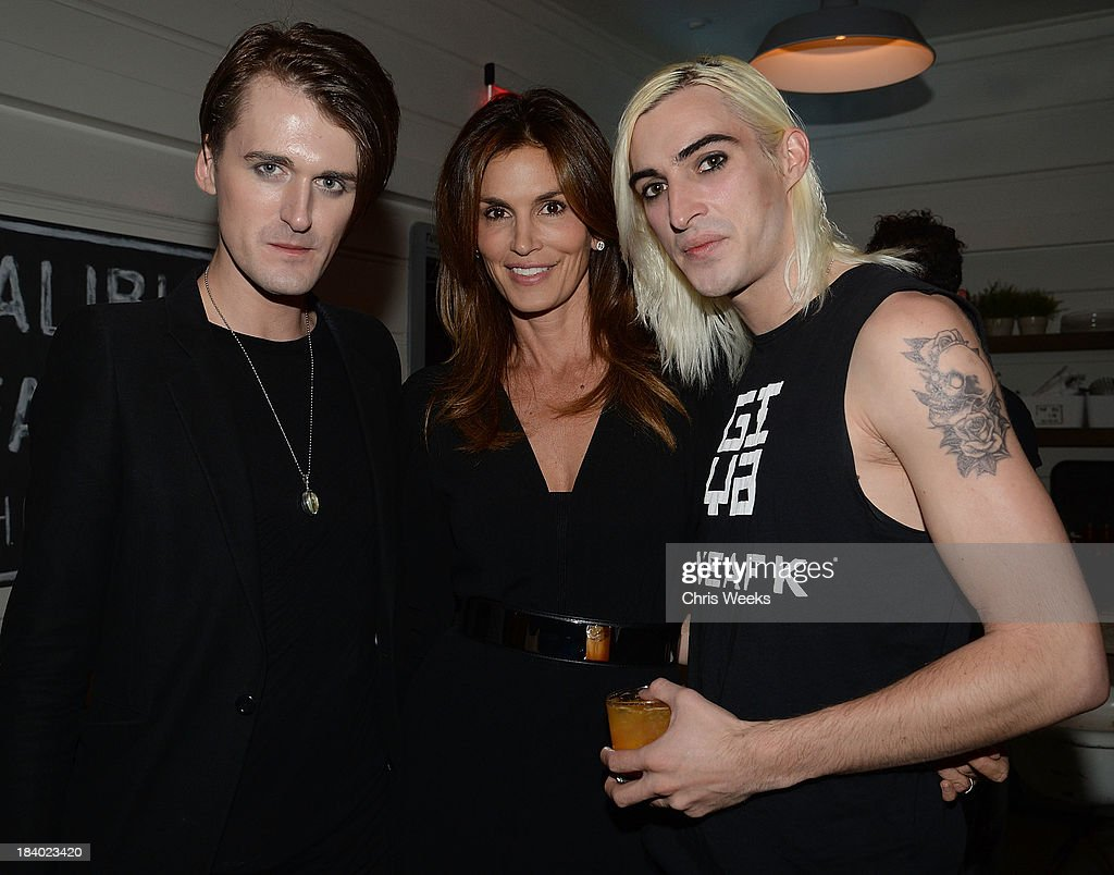 Fashion designer Gareth Pugh, <a gi-track='captionPersonalityLinkClicked' href=/galleries/search?phrase=Cindy+Crawford&family=editorial&specificpeople=202842 ng-click='$event.stopPropagation()'>Cindy Crawford</a> and Carson McCall attend a dinner for Pugh hosted by Chrome Hearts at Malibu Farm on October 10, 2013 in Malibu, California.