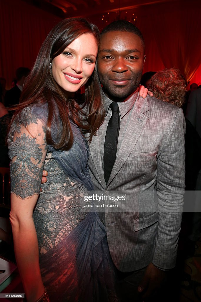 Fashion designer Georgina Chapman (L) and actor David Oyelowo attend The Weinstein Company's Academy Awards Nominees Dinner in partnership with Chopard, DeLeon Tequila, FIJI Water and MAC Cosmetics on February 21, 2015 in Los Angeles, California.