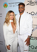 Fashion designer Germaine Renner and professional basketball player and founder of Active Dreamers Jack McClinton attend the Coach Woodson Las Vegas...