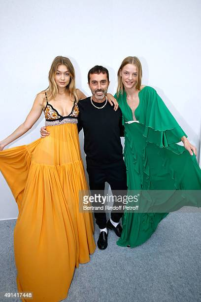 Fashion Designer Giambattista Valli poses between his Models after the Giambattista Valli show as part of the Paris Fashion Week Womenswear...
