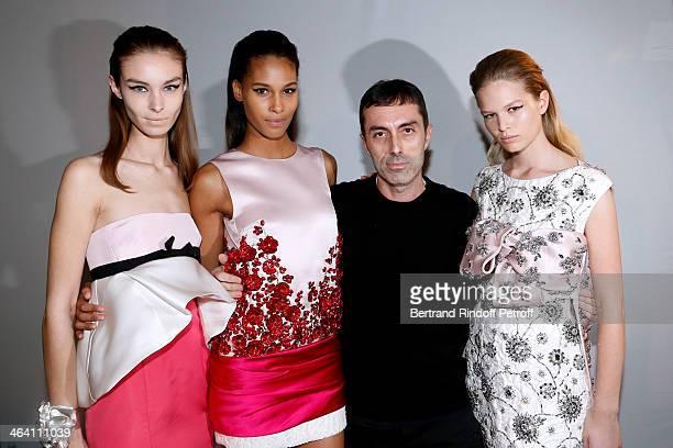 Fashion Designer Giambattista Valli poses with his models backstage after the Giambattista Valli show as part of Paris Fashion Week Haute Couture...