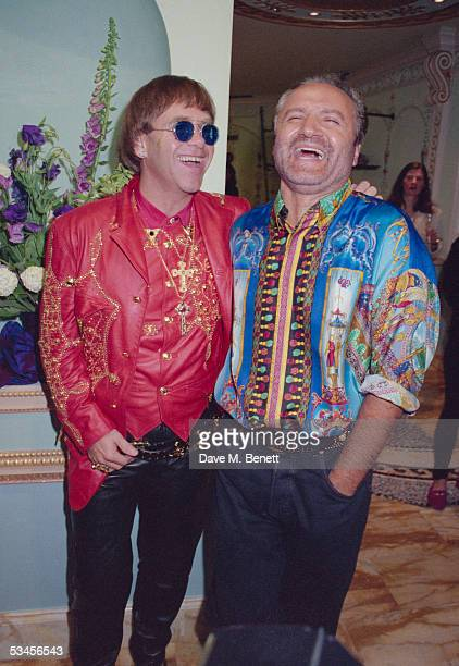 Fashion designer Gianni Versace enjoys a joke with singer Elton John at the opening of the new Versace shop 28th May 1992