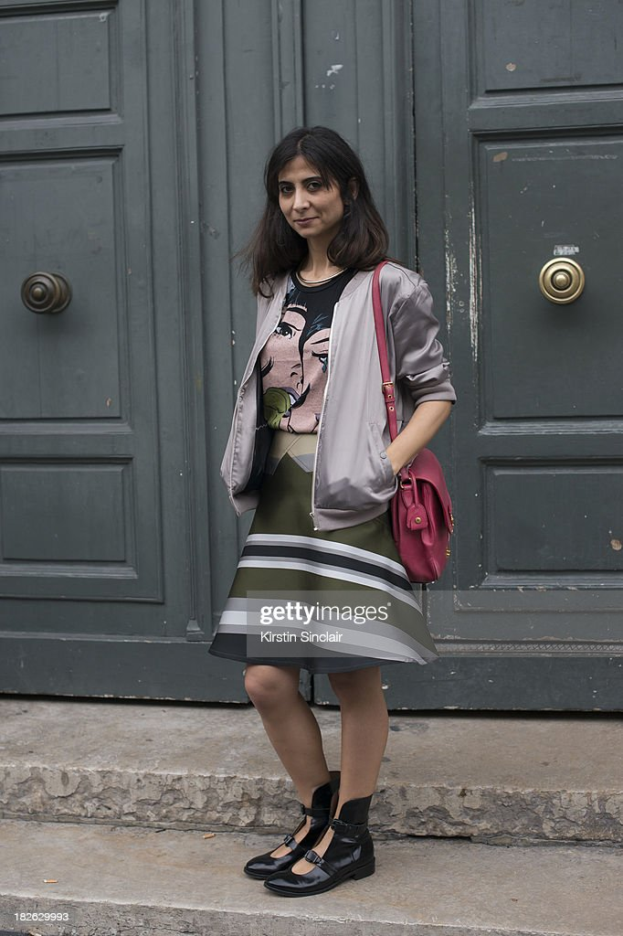 Fashion designer Giia Guldal Aydinli wears Otswald Helgason skirt, Adidas jacket, Miu Miu bag, Acne shoes and an Asos top on day 7 of Paris Fashion Week Spring/Summer 2014, Paris September 30, 2013 in Paris, France.
