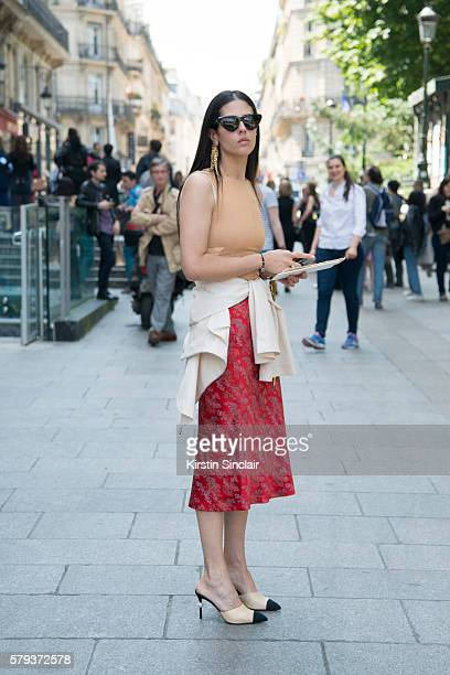Fashion designer Gilda Ambrosio wears a Maison Margiela top and skirt Loewe jacket and jewellery and Chanel shoes day 4 of Paris Haute Couture...