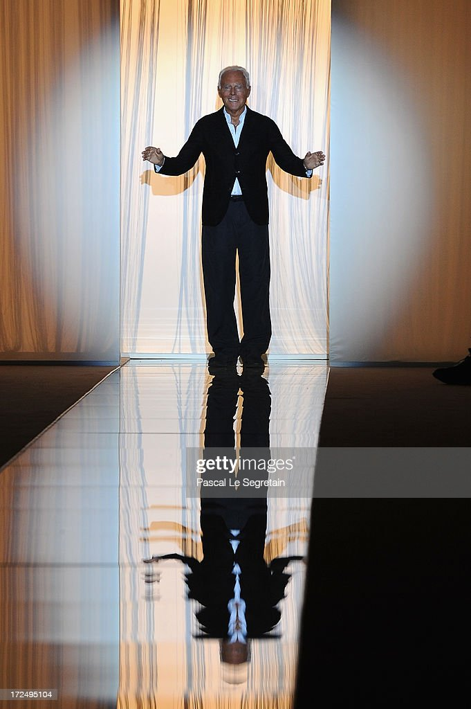 Fashion designer Giorgio Armani acknowledges applause following the Giorgio Armani Prive show as part of Paris Fashion Week Haute-Couture Fall/Winter 2013-2014 at Theatre National de Chaillot on July 2, 2013 in Paris, France.