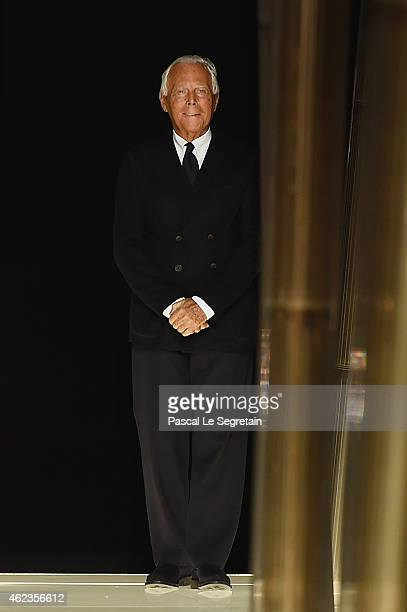 Fashion designer Giorgio Armani acknowledges the applause of the audience after his show as part of Paris Fashion Week Haute Couture Spring/Summer...
