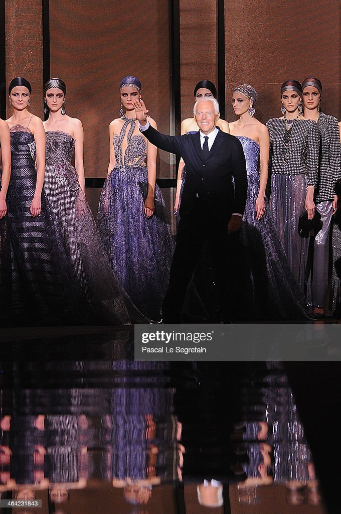 Fashion designer Giorgio Armani acknowledges the applause of the audience after the Giorgio Armani Prive show as part of Paris Fashion Week Haute...