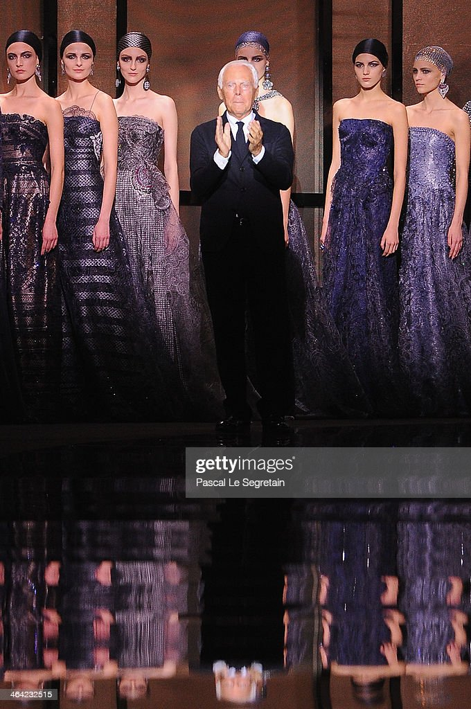 Fashion designer <a gi-track='captionPersonalityLinkClicked' href=/galleries/search?phrase=Giorgio+Armani&family=editorial&specificpeople=4155761 ng-click='$event.stopPropagation()'>Giorgio Armani</a> acknowledges the applause of the audience after the <a gi-track='captionPersonalityLinkClicked' href=/galleries/search?phrase=Giorgio+Armani&family=editorial&specificpeople=4155761 ng-click='$event.stopPropagation()'>Giorgio Armani</a> Prive show as part of Paris Fashion Week Haute Couture Spring/Summer 2014 on January 21, 2014 in Paris, France.