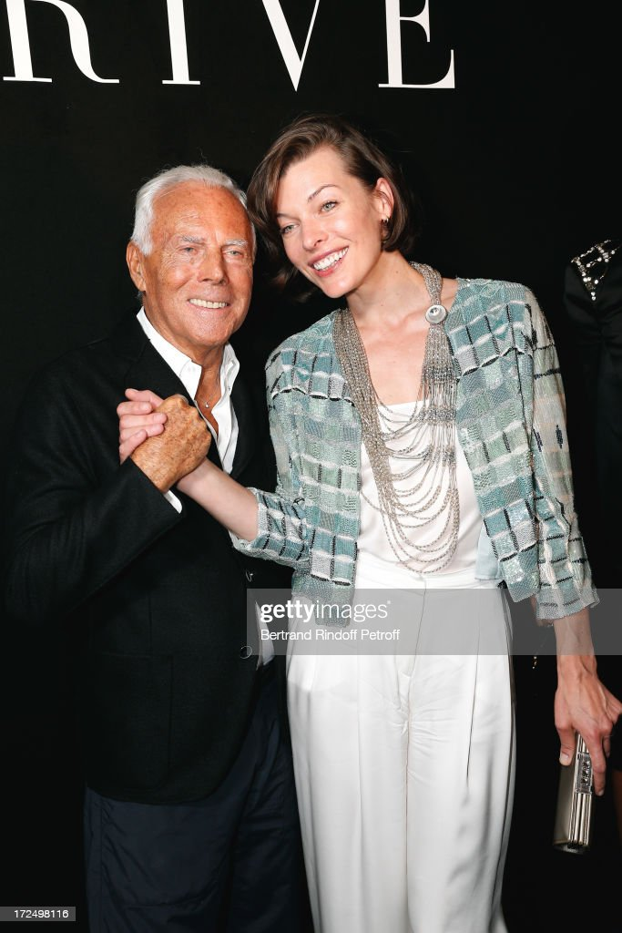Fashion Designer Giorgio Armani and actress <a gi-track='captionPersonalityLinkClicked' href=/galleries/search?phrase=Milla+Jovovich&family=editorial&specificpeople=202207 ng-click='$event.stopPropagation()'>Milla Jovovich</a> after the Giorgio Armani Prive show as part of Paris Fashion Week Haute-Couture Fall/Winter 2013-2014 at Theatre National de Chaillot on July 2, 2013 in Paris, France.