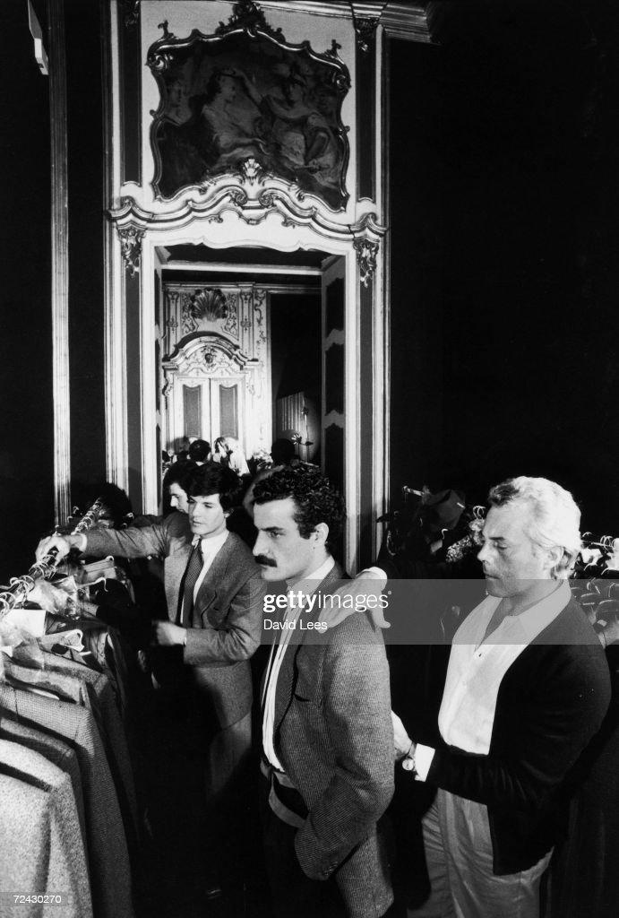 Fashion designer Giorgio Armani fitting a suit jacket