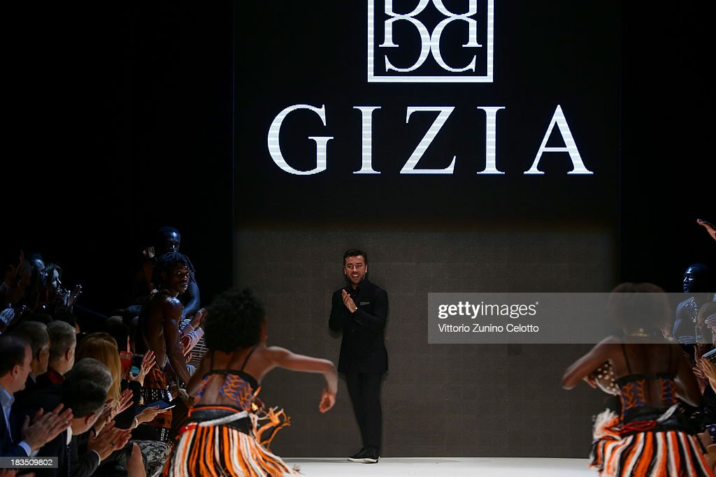Fashion designer Gizia walks the runway at the Gizia show during Mercedes-Benz Fashion Week Istanbul s/s 2014 on October 7, 2013 in Istanbul, Turkey.