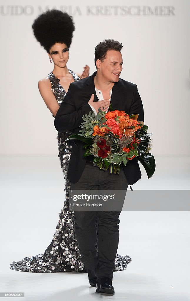 Fashion designer Guido Maria Kretschmer on the runway after his Autumn/Winter 2013/14 fashion show during Mercedes-Benz Fashion Week Berlin at Brandenburg Gate on January 17, 2013 in Berlin, Germany.
