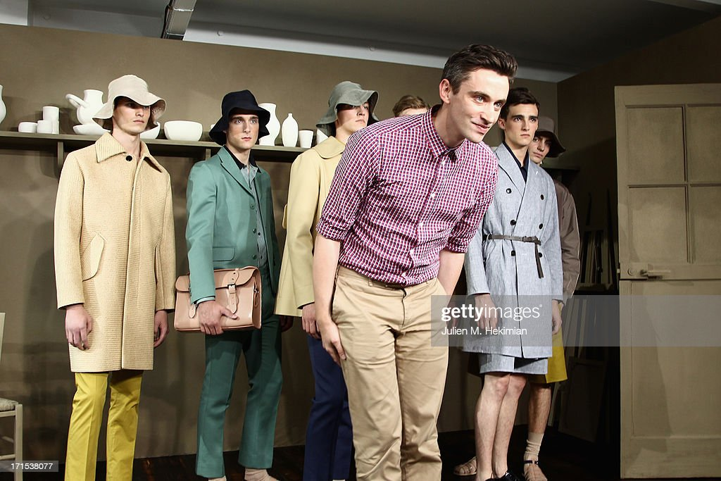 Fashion designer Guillaume Henry acknowledges applause following the Carven Menswear Spring/Summer 2014 show as part of the Paris Fashion Week on June 26, 2013 in Paris, France.
