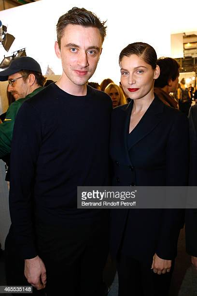 Fashion designer Guillaume Henry and model laetitia Casta pose backstage after the Nina Ricci show as part of the Paris Fashion Week Womenswear...