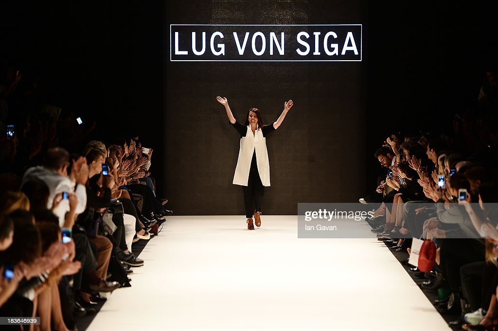 Fashion designer Gul Agis walks the runway at the Lug Von Siga show during Mercedes-Benz Fashion Week Istanbul s/s 2014 presented by American Express on October 8, 2013 in Istanbul, Turkey.