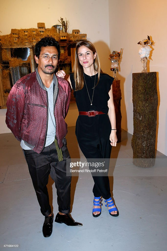 Fashion Designer Haider Ackermann and Coowner of the Gallery Victoire de Pourtales attend the 'A Moment of Reconstruction' Informal Dinner and...