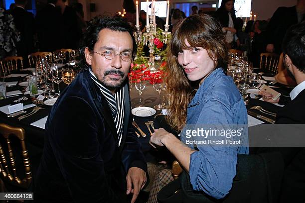 Fashion Designer Haider Ackermann and Lou Doillon attend the Annual Charity Dinner hosted by the AEM Association Children of the World for Rwanda...